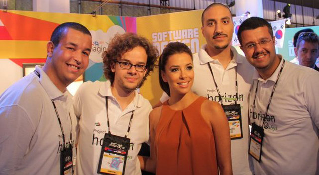 Oasys team members with Eva Longoria who walked by their booth and tested their system